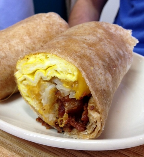 Bacon, egg, and cheese with tater tots on a wrap
