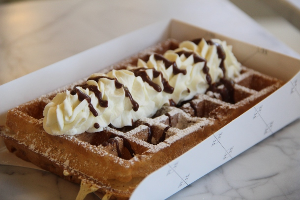 Belgian waffle with housemade whipped cream and chocolate sauce