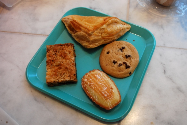 Apple turnover, chocolate chip cookie, madeleine, seven layer bar